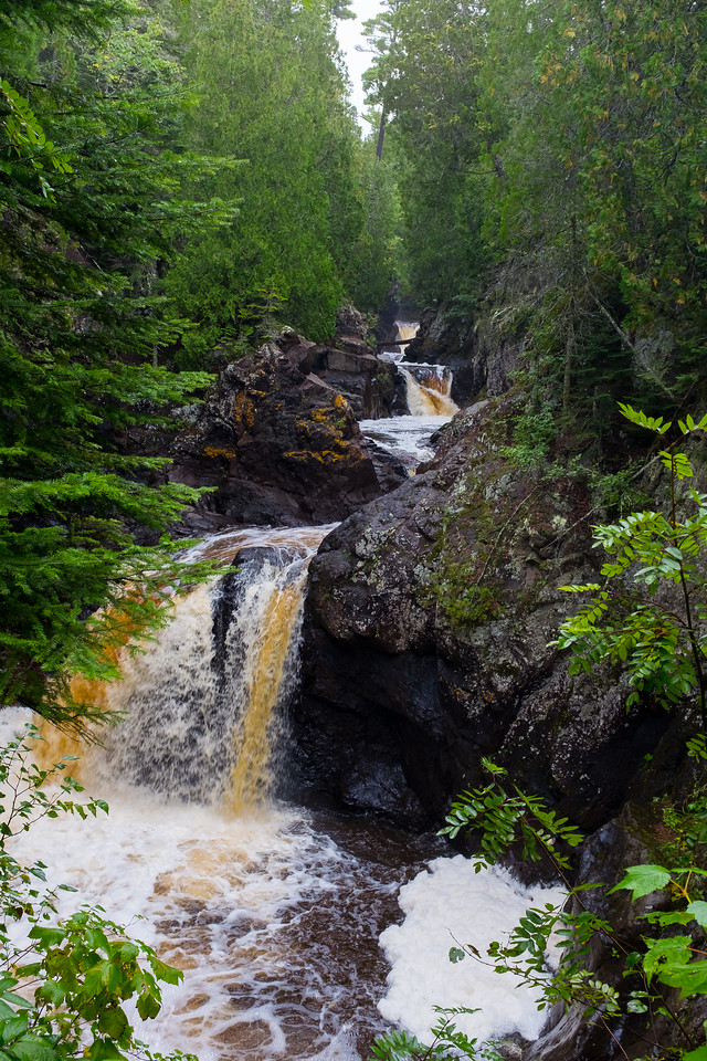 """The brown """"root-beer"""" coloring is natural. Cascade River's  source is a bogs up at a higher elevation."""