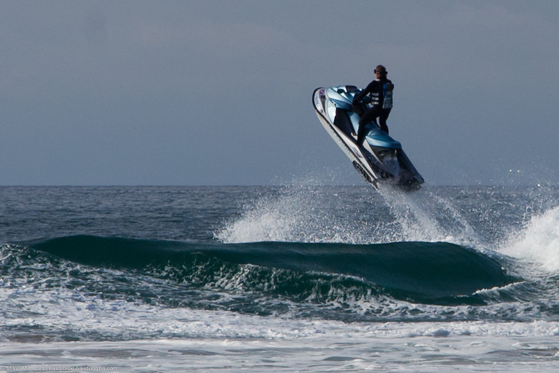 Man jumping a wave with his Personal Water Craft