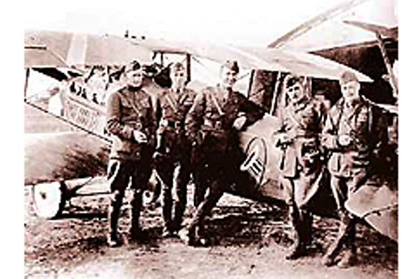 . Capt. Eddie Rickenbacker, center, America\'s Ace of Aces in World War I along with other members of the 94th Pursuit Squadron.