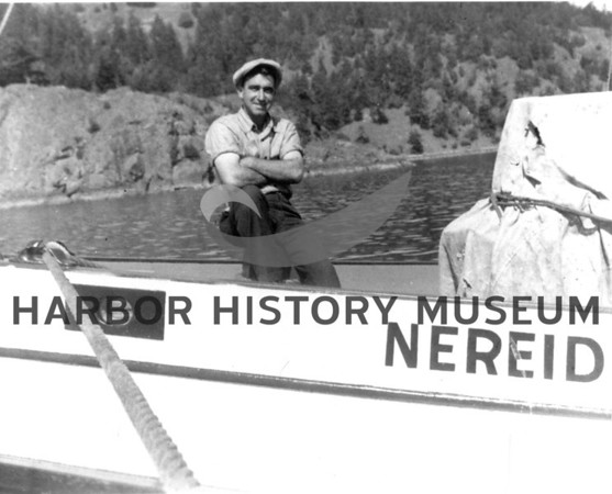 "Antone Skansie on ""Nereid"" at San Juan.  Boat owned by Friday Harbor Canning Co."