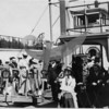 Source: R.C Mojian<br /> Date: 1918<br /> Visitors on board celebrating arrival of first ferry service to Gig Harbor.  Docked at the head of the bay.