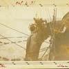 """Commercial fishing trip; man with driftwood; """"Monitor"""" (left) and """"Shenandoah"""" (right)."""