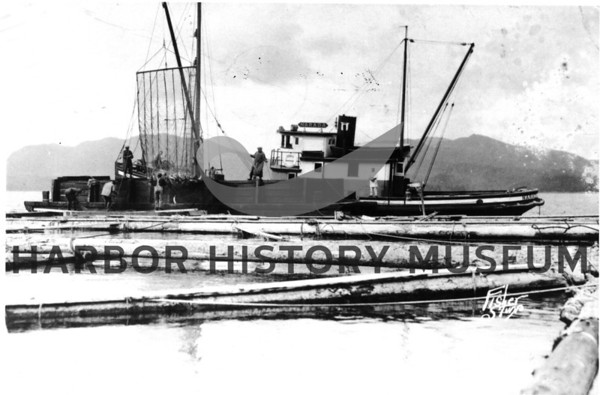 """Norada"" owned by Jack Reid<br /> Pulling in nets with bow boom.<br /> Braililng salmon from an Alaskan fish trap."