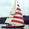 """Red Sailboat going """"down wind"""" with full sails"""