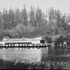 """Atalanta"" going out of Gig Harbor bay after 1910.  The large house on sandspit was probably the Rowley house.  The ""Atalanta"" was 6th of original Mosquito Fleet.  It did carry some cars on deck.  The ""Atalanta"" was built at shipyard of Marine Supply Co. in Tacoma for Tacoma & Burton Nav. Co. and  completed May 1913 by Hunt Bros.(Arda, Arthur & Lloyd).  First Captain was Arda.  111.7 ft. steamboat.  It carried passengers, mail and freight.  Made five stops in harbor area before going to Tacoma - three round trips daily.  Went to no. Puget Sound.  Converted to oil burner.  Renovated 1942 into houseboat.  <br /> It was sold to Puget Sound Nav. Co. in 1938 and scrapped.  Her hull was burned  on upper Puget Sound two years later."