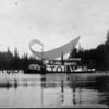 "The ""Bay Island"" loaded with crates of strawberries for shipment to Tacoma.  Taken at Picnic Point, Wollochet Bay after 1912.  The area directly behind boat and to the right is the present location of the Tacoma Yacht Club dock.  Farmers formed Hales Pass & Wollochet Navigation Co.  The ""Crest"" was purchased by the Hales Pass and Wollochet Navigation Co in 1912 and renamed the ""Bay Island"".  From Mrs. C.F. McCormick."