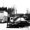 Source:  Unknown<br /> Date:  1923-1928<br /> West side Mercantile Store - seven (7) cars in line - waiting for ferry - Peoples Dock.
