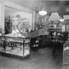 Source:  Hammerlund collection<br /> Ted in Jamison Pharmacy on University Way, Seattle.<br /> Edwin Hammarlund (center) owned and operated Hammerlund Pharmacy in Greenlake District of Seattle for 42 years.