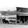 Source:  Clayton Kimball<br /> St. Peter Bros. Groceries & Feed, with horse drawn delivery wagon, located in Millville area of Gig Harbor