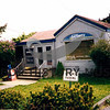 Source:  Arveida Livingston<br /> The Peninsula Gateway office shortly before they moved to 3555 Erickson Street, Gig Harbor.  Grand opening with tours July 24, 1997 (7521 Pioneer Way).  <br /> Former Cosulich home.