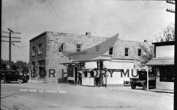 Novak bldg  1920s; corner of today's Pioneer Way and Harborview Drive.