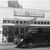 Source:  Ebba Uddenberg<br /> Gig Harbor Hardware, downtown Gig Harbor.  Harbor Inn parking lot.  Owners:  Ralph and Allan Colby.   First police car parked in front.