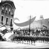 #008<br /> Arthur Sandin's Navy group marching in parade formation.  Spokane Hotel is one building.