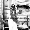 Source:  Dick Whlman     <br /> Date:  Unknown<br /> Mrs. Squally of the Nisqually Indian Tribe -  Pt. Fosdick.<br /> As a young women with unbraided hair - reaching to her knee. Reservation