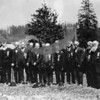 Source:  Jean Lyle Roberton     <br /> Date:  before 1922    <br /> Gig Harbor members of the Grand Army of the Republic (G.A.R.) - a civil war veterans group, pose for a photograph in Gig Harbor (in road by downtown Church.<br /> Included in the photograph is Miles B. Hunt (5th from right) who served with the Michigan Cavalry and was discharged after receiving a head wound.  His friend and fellow member of the Michigan Cavalry, Thaddeus Waters (4th from right), spent time as a prisoner of war in the infamous Andersonville prison and later wrote a book about his experiences.  Other identified veterans in the picture are Joseph Allen (1st from the left), William Peacock (5th from the left) and Joseph Goodman (10th from left-front).