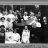 Source:  Jean Lyle Roberton     <br /> Date:  1918     <br /> W.R.C. - Womens Relief Corps - Auxillary to the GAR.<br /> Front Row:  Mrs. Kingsbury, Mrs. Wroten, Goldie Wroten and Mr. and Mrs. Shyleen. <br /> 2nd Row:  ______, Mrs. Lillie (Hunt) Patrick, M. B. Hunt, Maritla Hunt, ______, Mrs. Atkinson, John Atkinson.<br /> 3rs Row:  ______, ______, ______, ______, Art Gellerman, ______ , ______, ______, Mrs Allen, Mrs L. C. Cruner, ______, <br />       Mrs.  Wroten.<br /> <br /> G.A.R. - Grand Army of the Republic (the northern armies in the Civil War).  their activities would have been something like the V.F.W.  The G.A. R. Hall which these people are in front of was torn down to make room for Town Hall across from Don's drug.