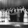 Source:  Judy Gillette (Beardsley     <br /> Date:  1950-52.     <br /> Peninsula Singers. <br /> L - R Bottom:  _____, _____, _____, _____, _____, Howard Roland, _____, _____, Arnold (Stub) Meyer, Ruth Little,        Grace Beardsley.<br /> Middle Row:  _____, Ruth Ryan, _____, Wm. Samuelson, Gilbert Morgan, _____, _____, _____.<br /> Back Row:  _____, _____, _____,Martin Samuelson, Erick Erickson, _____, Gwenyth Nightingale, Nancy Austin