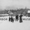 Family posed in the snow near small house in Cromwell  Source:  Hageness