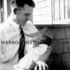 Edwin Hammarlund with Juean H.  Home,  16 days old.<br /> 1927