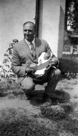Dr. Arthur S. Monzingo   July 18th 1927 with 1st and only Grandchild, Shirley Elizabeth Monzingo.