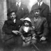 Source:  Minnie Malich     <br /> Date:  Unknown     <br /> Back row:  ______, Pete Bujacich<br /> Front row:  John Smircich, Johnnie Lovrovich and dad, John
