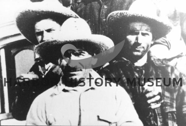 Source:  Minnie Malich     <br /> Date:  Unknown     <br /> Marco Malich in center - other men not identified.