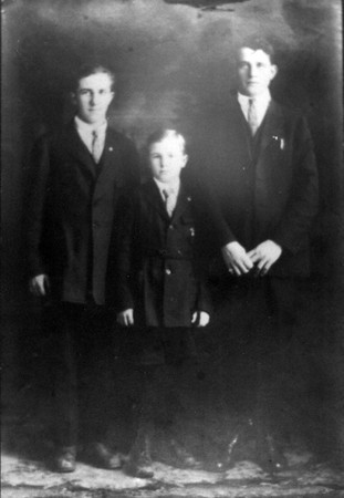 Source:  Minnie Malich     <br /> Date:  Unknown     <br /> John, Marci, and Ned Malich.