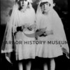 Source:  Minnie Malich    <br /> Date:  Unknown     <br /> Two little girls in communion dress - possibly Lovrovich.