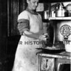 Source:  Jean Lyle     <br /> Date:  Spring, 1914     <br /> Lillie Hunt Patrick - interior of old home kitchen.