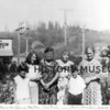 Source:  Unknown     <br /> Date:  c. 1930 <br /> Eunice (Morin) Vlahovich, Mary Morin, Lubie Pusich, ___, Martin (Sonny) Morin, Godenta Skrivanich, in front of Stanich Grocery story on Harborview Drive.