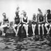 Swimmers at edge of Samuelson's water tank.