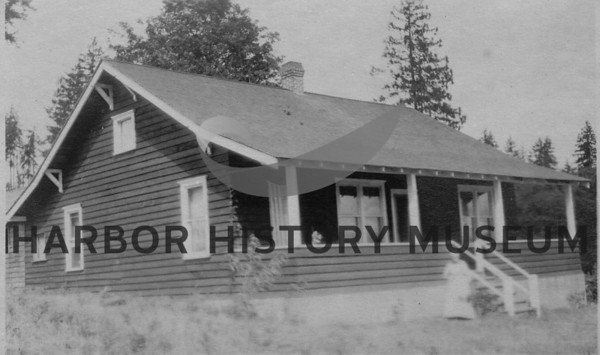 Kimball house located below original home on Stinson hill.  <br /> Anna Kimball, grandmother of Helen Clayton, standing by steps leading to front porch.