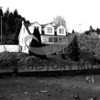 Former home of Axel Uddenberg house at low tide 4/11/1948 at North Gig Harbor.  <br /> Upper porch now enclosed with large windows.<br /> Road no longer runs in front of house by water.<br /> No longer a grocery.