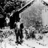 Stinson's father standing in front of his home.