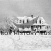 Greenwood residence, East Wollochet, in the snow.  Later owned by Will Hogarty.  Source:  Pearson