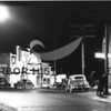 Photographer:  Frank Shaw<br /> Night scene west Gig Harbor business district; Roxy Theater- 1949