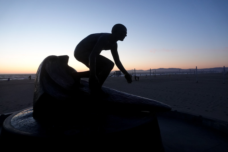The iconic surfing statue at the foot of the Hermosa Beach Pier just after sunset