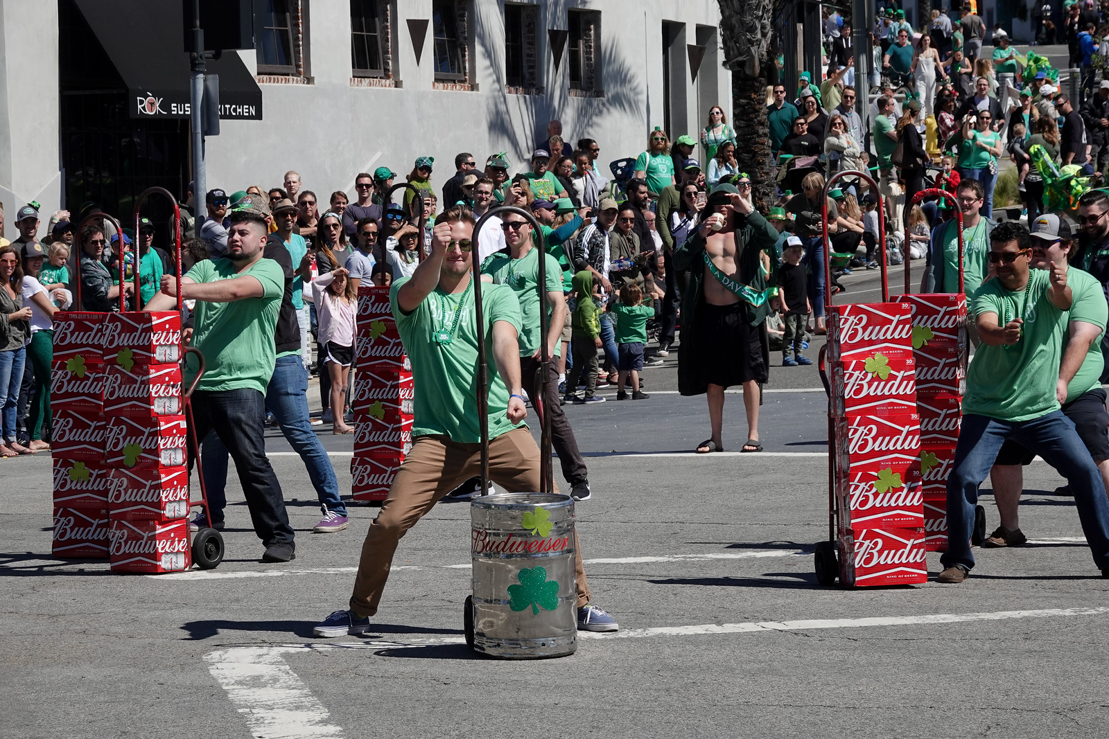 Budweiser reps dance away during a St. Patrick's Day parade in Hermosa Beach