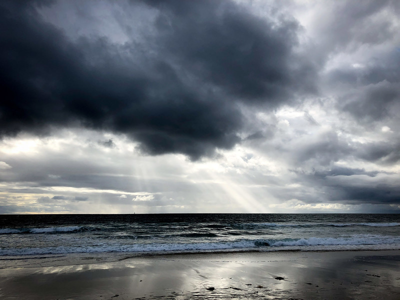 Dramatic skies over Hermosa Beach ocean
