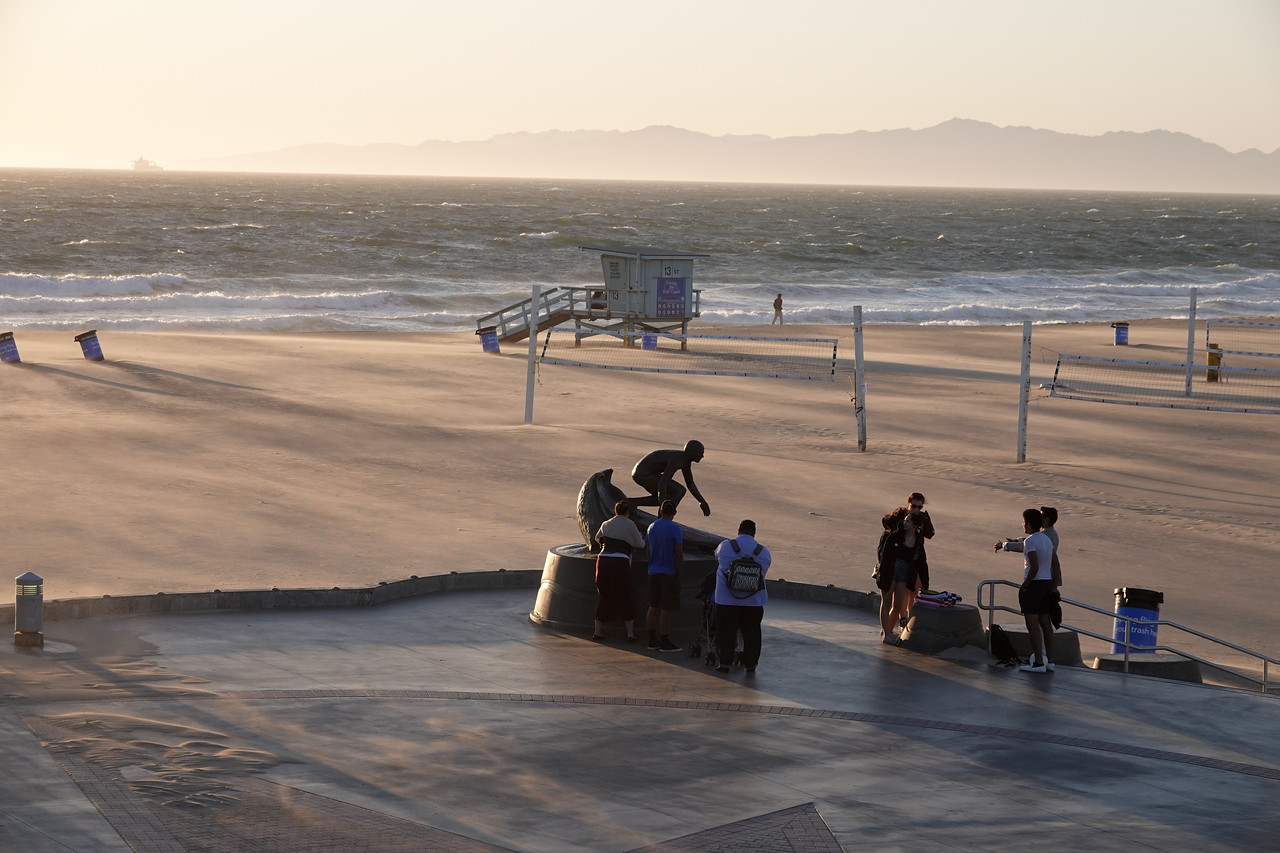 No matter what the weather, people always line up to get their photos taken by the surf statue. This would be a very windy day in Hermosa Beach