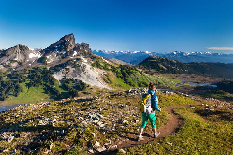 A young woman hiking on the Panorama Ridge Trail in Garibaldi Provincial Park, British Columbia, Canada.