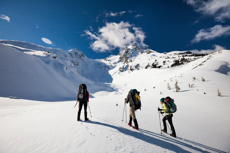 Three climbers head  towards the summit of Joffre Peak, British Columbia, Canada.