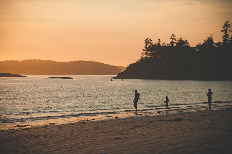 A family enjoys a beach in Pacific Rim National Park.