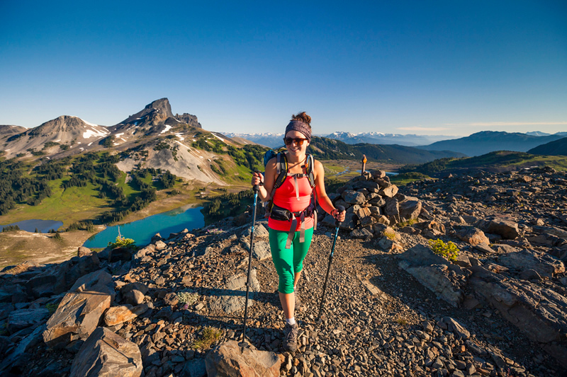 A young woman hiking on the Panorama Ridge Trail in Garibaldi Provincial Park, British Columbia, Canada.