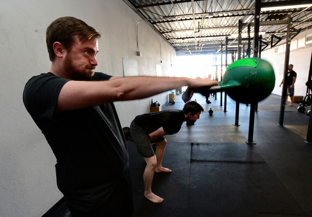 . James Lengyel finishes a difficult set of Dead Stop Swings during the Hardstyle Kettlebell class at Barbell Strategy on Monday. For more photos go to dailycamera.com. Paul Aiken Staff Photographer Nov 20 2017