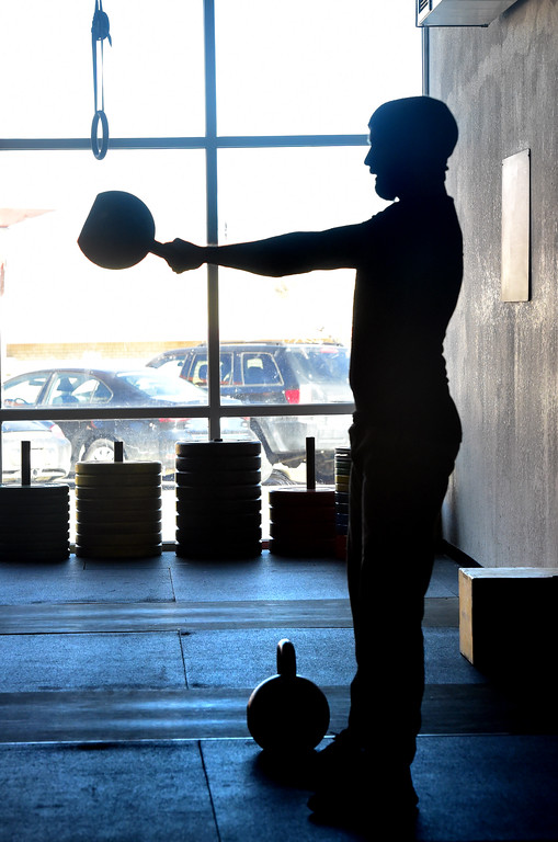 . Todd Sullivan performs a set of Swings during the Hardstyle Kettlebell class at Barbell Strategy on Monday. For more photos go to dailycamera.com. Paul Aiken Staff Photographer Nov 20 2017