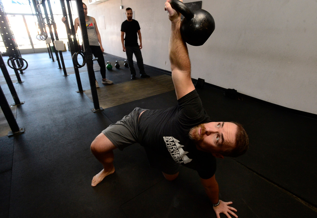 . Instructor Jeremy Layport demonstrates a Turkish Get Up during the Hardstyle Kettlebell class at Barbell Strategy on Monday. For more photos go to dailycamera.com. Paul Aiken Staff Photographer Nov 20 2017