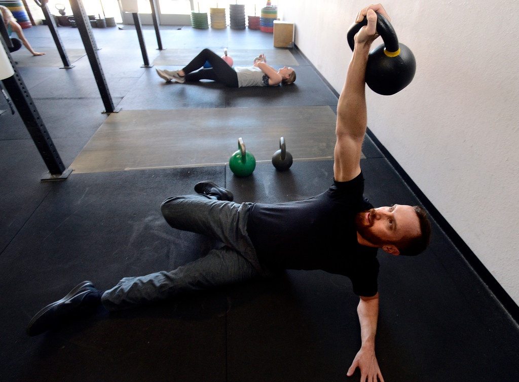 . Todd Sullivan performs a Turkish Get Up during the Hardstyle Kettlebell class at Barbell Strategy on Monday. For more photos go to dailycamera.com. Paul Aiken Staff Photographer Nov 20 2017