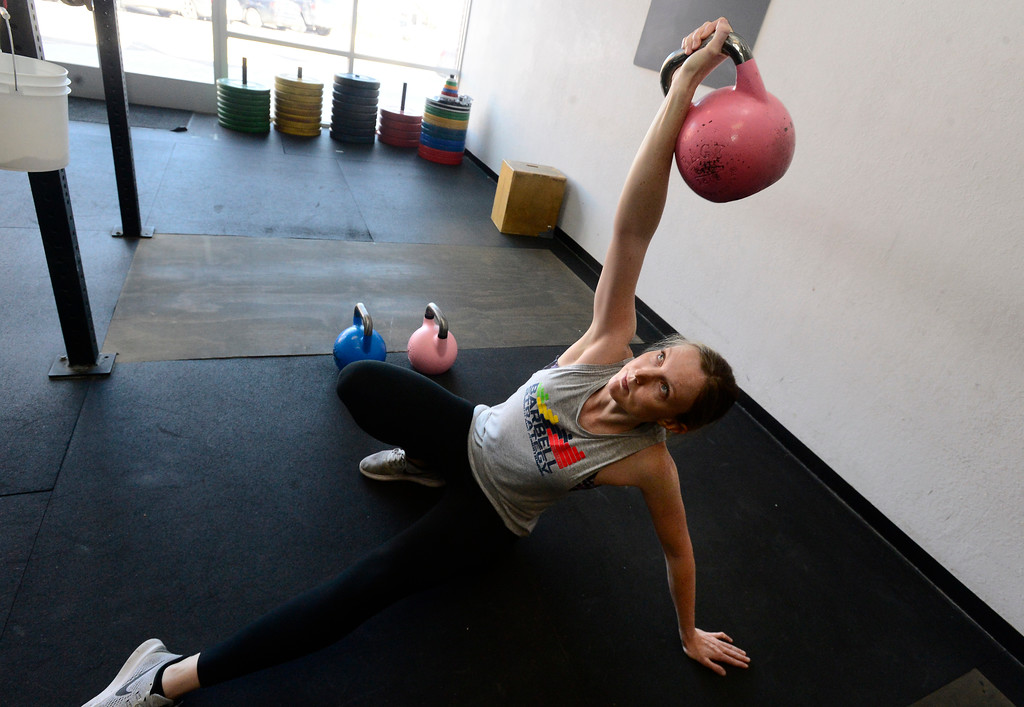 . Lauren Sullivan performs a Turkish Get Up during the Hardstyle Kettlebell class at Barbell Strategy on Monday. For more photos go to dailycamera.com. Paul Aiken Staff Photographer Nov 20 2017