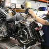American Harley Davidson in Leominster on Central Street is celebrating their 40th year in business in 2016. Michael Locke works on a bike in the shops service area on Thursday. He has been with the shop for 17 years. SENTINEL & ENTERPRISE/JOHN LOVE